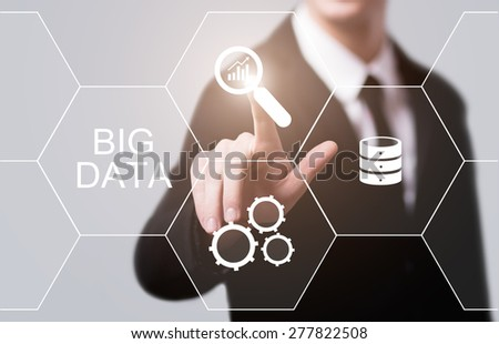 business, technology and internet concept - businessman pressing big data button on virtual screens - stock photo