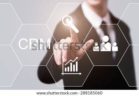 business, technology and internet concept - businessman pressing crm button on virtual screens - stock photo