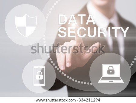 business, technology and internet concept - businessman pressing data security button on virtual screens - stock photo
