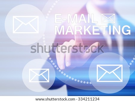 business, technology and internet concept - businessman pressing e-mail marketing button on virtual screens - stock photo
