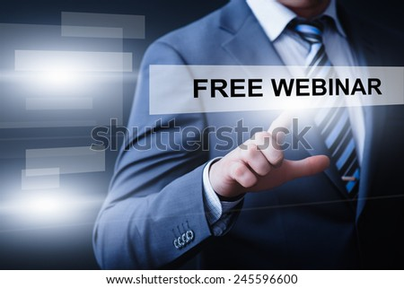 business, technology and internet concept - businessman pressing free webinar button on virtual screens - stock photo