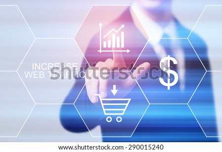 business, technology and internet concept - businessman pressing increase web traffic button on virtual screens - stock photo