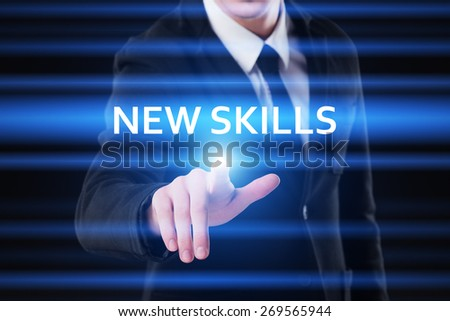 business, technology and internet concept - businessman pressing new skills button on virtual screens - stock photo