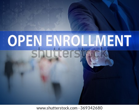 business, technology and internet concept - businessman pressing open enrollment button on virtual screens - stock photo