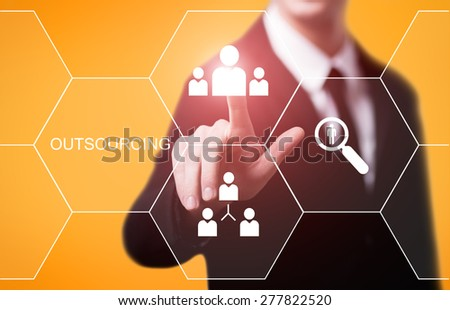 business, technology and internet concept - businessman pressing outsourcing button on virtual screens - stock photo