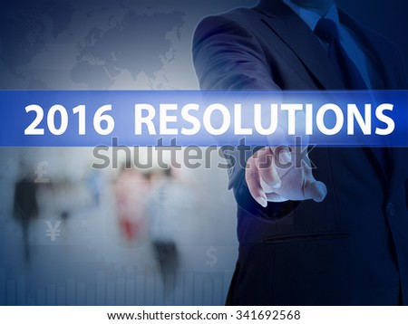 business, technology and internet concept - businessman pressing 2016 resolutions button on virtual screens - stock photo
