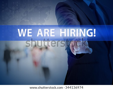 business, technology and internet concept - businessman pressing we are hiring button on virtual screens - stock photo