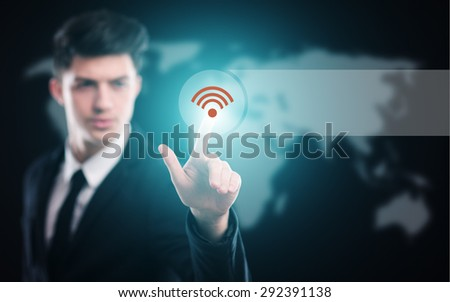 business, technology and internet concept - businessman pressing wi-fi button on virtual screens - stock photo
