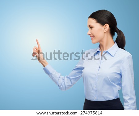 business, technology and people concept - businesswoman pointing finger to or touching something imaginary over blue background - stock photo