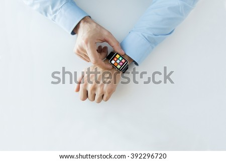 business, technology and people concept - close up of male hands setting smart watch with application icons on screen - stock photo