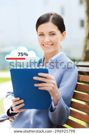 business, technology, cloud computing and people concept - young smiling woman with tablet pc computer and internet icon transferring data sitting on bench in city - stock photo