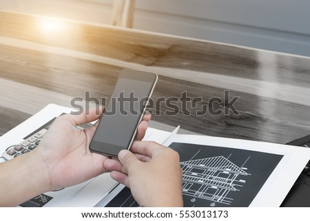business technology concept,Business people hands use smart phone and laptop for business analyst project on table.,selective focus.