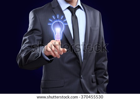 business, technology concept - businessman pressing button with bulb on virtual screens - stock photo