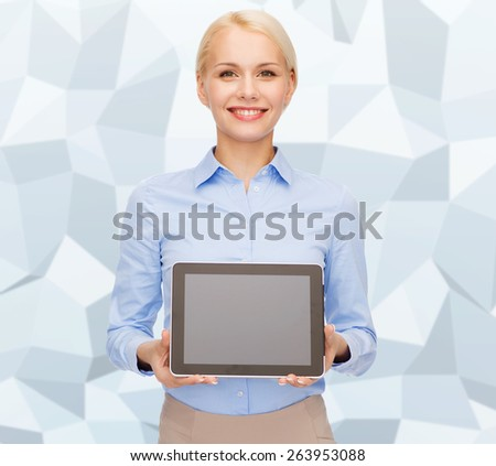 business, technology, internet and advertisement concept - smiling businesswoman with blank black tablet pc computer screen over gray graphic low poly background - stock photo