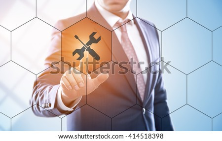 business, technology, internet and customer service concept. Businessman pressing technical support button on virtual screens with hexagons and transparent honeycomb - stock photo