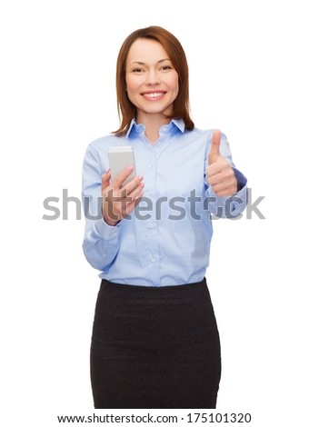 business, technology, internet and education concept - friendly young smiling businesswoman with smartphone showing thumbs up - stock photo