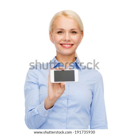 business, technology, internet and education concept - friendly young smiling businesswoman with smartphone blank screen
