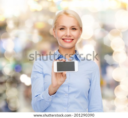 business, technology, internet and education concept - friendly young smiling businesswoman with smartphone blank screen - stock photo