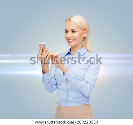 business, technology, internet and education concept - smiling young businesswoman with smartphone over gray background - stock photo