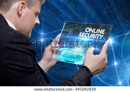 Business, Technology, Internet and network concept. Young business man, working on the tablet of the future, select on the virtual display: Online security