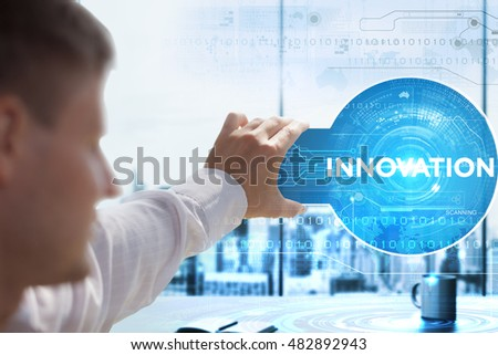 Business, Technology, Internet and network concept. Young businessman looks on a tablet, smart phone of the future. He sees the inscription: innovation