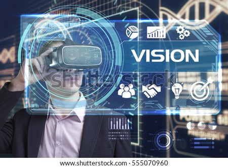 Business, Technology, Internet and network concept. Young businessman working in virtual reality glasses sees the inscription: vision