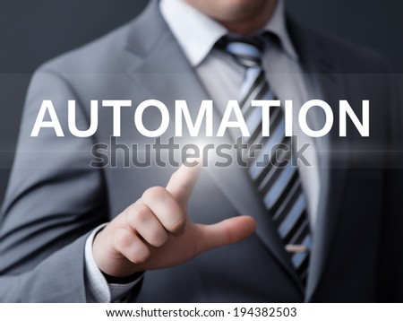 business, technology, internet and networking concept - businessman pressing automation button on virtual screens
