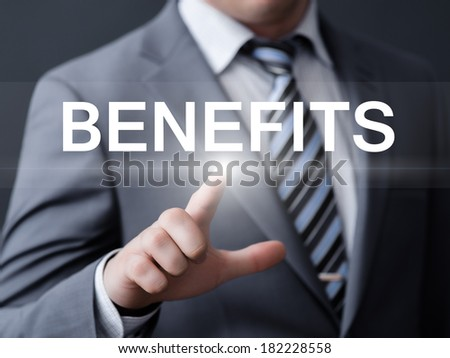 business, technology, internet and networking concept - businessman pressing benefits button on virtual screens - stock photo