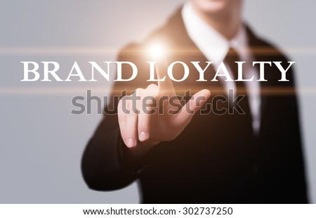 business, technology, internet and networking concept - businessman pressing brand loyalty button on virtual screens