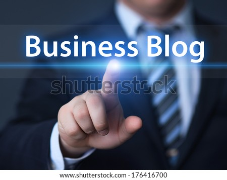 business, technology, internet and networking concept - businessman pressing business blog button on virtual screens - stock photo