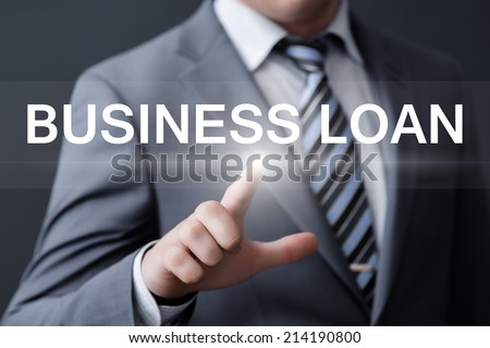 business, technology, internet and networking concept - businessman pressing business loan button on virtual screens - stock photo