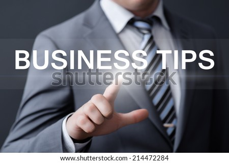 business, technology, internet and networking concept - businessman pressing business tips button on virtual screens - stock photo