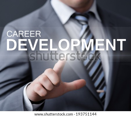 business, technology, internet and networking concept - businessman pressing career development button on virtual screens - stock photo