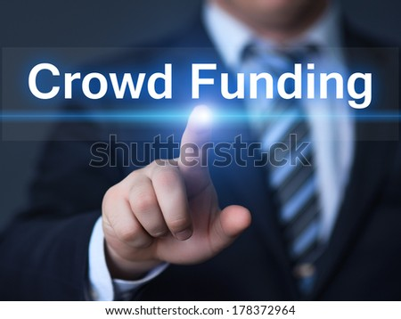 business, technology, internet and networking concept - businessman pressing crowd funding button on virtual screens - stock photo