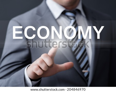 business, technology, internet and networking concept - businessman pressing economy button on virtual screens - stock photo