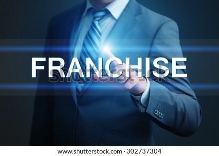 business, technology, internet and networking concept - businessman pressing franchise button on virtual screens