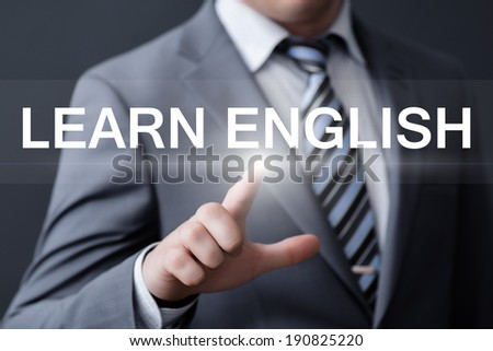 business, technology, internet and networking concept - businessman pressing learn english button on virtual screens - stock photo