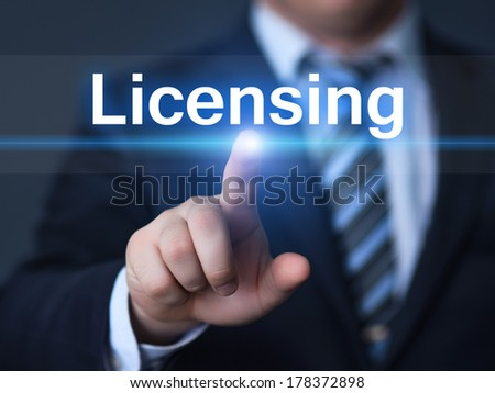 business, technology, internet and networking concept - businessman pressing licensing button on virtual screens - stock photo