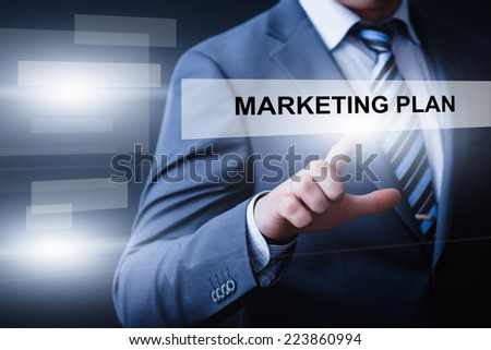 business, technology, internet and networking concept - businessman pressing marketing plan button on virtual screens - stock photo