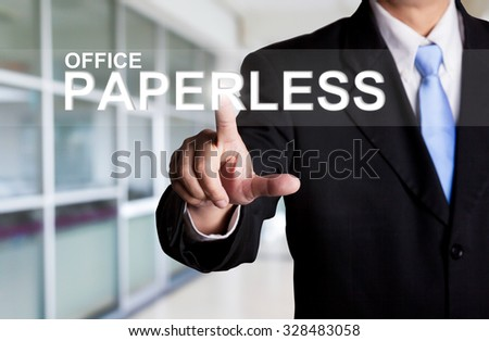 business, technology, internet and networking concept - businessman pressing office paperless button on virtual screens - stock photo