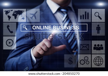 business, technology, internet and networking concept - businessman pressing online business button on virtual screens - stock photo