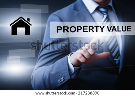 business, technology, internet and networking concept - businessman pressing property value button on virtual screens