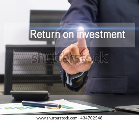 business, technology, internet and networking concept - businessman pressing return on investment button on virtual screens