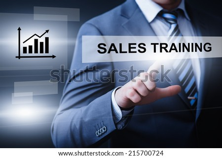 business, technology, internet and networking concept - businessman pressing sales training button on virtual screens - stock photo