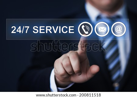 business, technology, internet and networking concept - businessman pressing 24/7 service button on virtual screens - stock photo