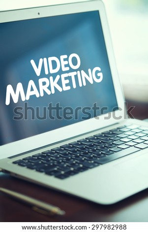 Business, technology, internet and networking concept. Open notebook with a sign on the screen of video marketing is on the table robochem. - stock photo
