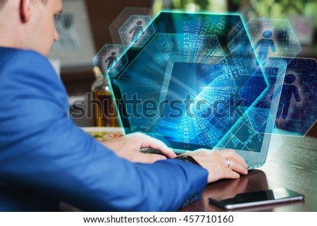 Business, Technology, Internet and networking concept. Young businessman working on his laptop of the future, working with the virtual screen hologram.