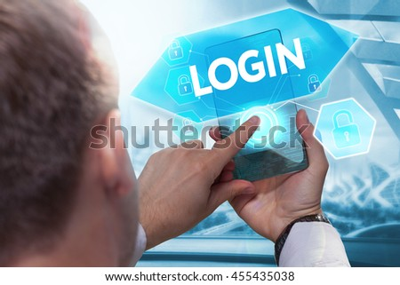 Business, technology, internet and networking concept. Young businessman working on his smartphone in the office, select the icon  login on the virtual display.