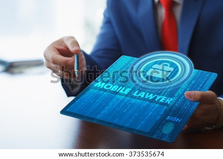 Business, technology, internet and networking concept. Young businessman working on his tablet in the office, select the icon lawyer on the virtual display. - stock photo