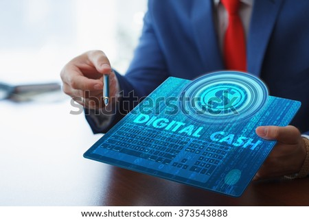 Business, technology, internet and networking concept. Young businessman working on his tablet in the office, select the icon digital cash on the virtual display. - stock photo